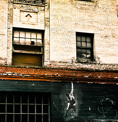 Seattle Street Art (Simple Insomnia) Tags: seattle city windows urban man brick art wall graffiti washington drawing climbing indie decal capitolhill