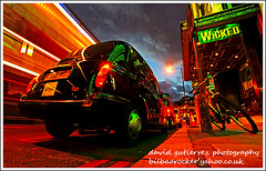 Wicked London at Night ; Theatre of Light (david gutierrez [ www.davidgutierrez.co.uk ]) Tags: city light urban bus green london colors night dark spec