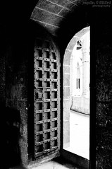 Door to wisdom (|||*Sue*||| perishableperspectives) Tags: door travel light bw white holiday black castle de island spain nikon shadows spanish heavy mallorca palma beautifull espagna balearic d5000