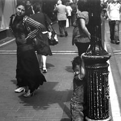 Romany Gypsy Child & Mother (Anthony Cronin) Tags: street ireland dublin 6x6 analog photography all rights neopan ac agfa folders agfaisolette irlanda xtol isolette foldingcamera irelanddublin gypsychildren solinar lifeliving dublinlife photographystreet agfaisoletteiii dublindublin dublinirish romachild formatfolding eldocumental y48filter streetdublin irishcharacter romanygypsies anthonycronin streetsdublin solinarlens fotografíadelacalle reservedirish photographystreets dublindublinersinside dublinliving romainireland analogsimpliciusapug© irelandagfa iiicolor skoparmedium camera6x6120filmdevrecipe5418fuji neopankodak xtolfilmbrandfujifilmnamefuji 400filmiso400developerbrandkodakdevelopernamekodak callededublín tpastreet anthonycroninfolio photangoirl