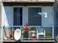 Quality time together (Krasny Fotograf) Tags: life people woman man couple dish eating balcony fat bald flats bikini balconies slovakia blocks block everyday sunbathing sattelite trnava slovak normality normalcy slovaks panelaks