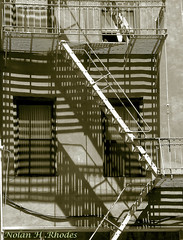 Untitled (nrhodesphotos(the_eye_of_the_moment)) Tags: windows building metal sepia concrete wiring shadows angles fireescape railing electrical ladders nrhodesphotosyahoocom wwwflickrcomphotostheeyeofthemoment theeyemomentphotosbynolanhrhodes dscn0093nhrt