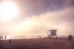 Huntington Beach (jdhilger) Tags: ocean people bird beach clouds sand huntington coastline huntingtonbeach lifeguardtower