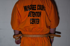 MUSCOGEE_3338 (skinmate) Tags: orange uniform jail jumpsuit inmate restraints
