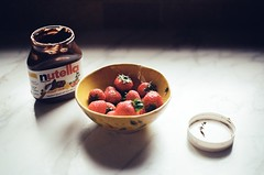 day one-hundred-eighty-five. (fivefortyfive) Tags: film 35mm dessert counter thing strawberries bowl snack nutella 365 minoltax370 lid alternate fivefortyfive inspiredbyeveryfoodpictureever flickrsortofkilledthecolorsonthis maggieannre