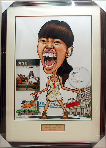 Caricature of Singapore singer Serene Koong 龚芝怡 with cd and album cover in frmae with metal engraving plate