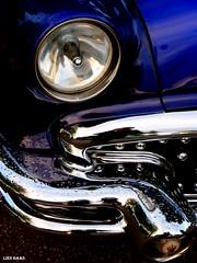Bold, Blazing and Blue (LiesBaas) Tags: auto blue light car buick automobile blauw ride head colorphotography denhaag bleu bumper raindrops hotrod rod headlight oldtimers thehague 2010 colourphotography regendruppels oltimer voorlicht kleurenfotografie liesbaas hunkydoory amerikanenmeetingthehague boldblazingandbluebyliesbaas