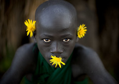 Surma boy with yellow flowers - Tulgit Omo Ethiopia (Eric Lafforgue) Tags: flowers boy fleur kid child artistic culture bodylanguage tribal ornament tribes bodypainting tradition tribe ethnic rite surma tribo adornment pigments ethnology tribu omo eastafrica thiopien suri etiopia 1362 ethiopie etiopa  etiopija ethnie ethiopi  etiopien etipia  etiyopya  nomadicpeople      tulgit    peoplesoftheomovalley