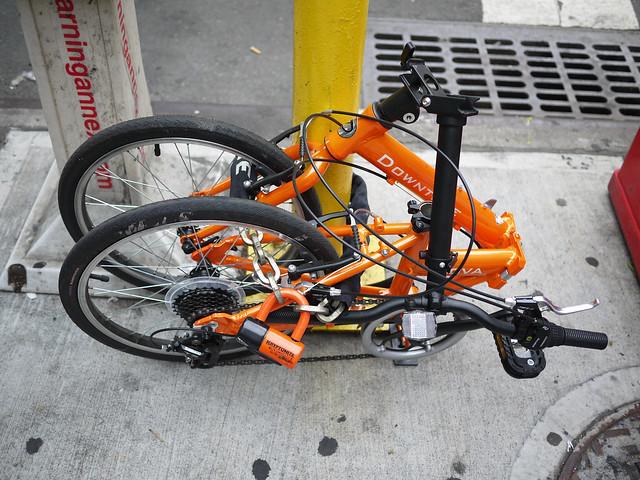 bike wrapped around a pole #walkingtoworktoday
