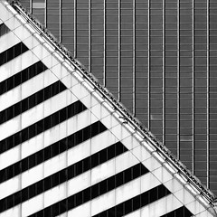 Slanted Stone (The New No. 2) Tags: bw white chicago abstract black building window glass monochrome lines stone illinois gbrearview steel angles michiganave il straight slant slope smurfit smurfitstone chicagoist dtail johncrouch johncrouchphotography crouchphotos
