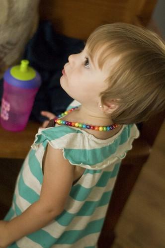 in her 'rainbow brite' necklace
