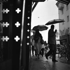 a souvenir from switzerland (The Cassandra Project) Tags: bw 6x6 film monochrome rain umbrella vintage schweiz switzerland suiza swiss luzern tourist souvenir diafine sw expired svizzera lucerne regen sveitsi yashicamat124g casagrande fomapan100 regenschirm mittelformat schweizerkreuz imgrendel grendelstrasse