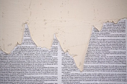 Torn pages on a wall in Montmartre, Paris