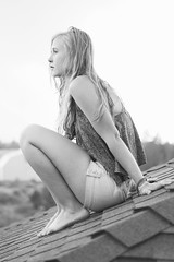 touched down in the land of the delta blues (lanuiop) Tags: roof portrait blackandwhite woman girl barn outside high sitting tank natural legs bright top shingles free teen fabric apex thinking barefoot blonde hippie curve loose shortshorts introspective hunched fullbody
