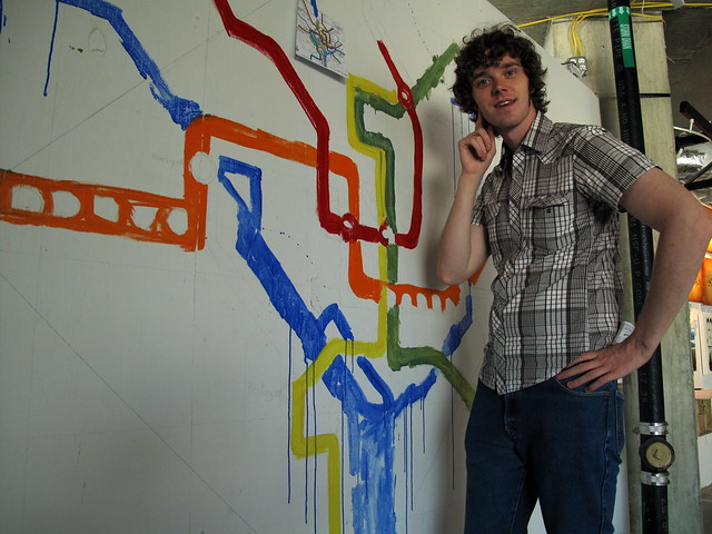 Matthew Hurst inspects artwork based on the DC metro transit map