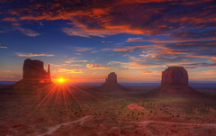 Sunrise (Wolfgang Staudt) Tags: road morning travel red arizona sky usa sun mountains southwest nature colors beautiful yellow clouds america sunrise wonder landscape early utah amazing hit nikon sandstone holidays butte view shot desert tripod sigma roadtrip wilderness navajo monumentvalley vacancy sonnenaufgang hdr mesa bluff 2010 tafelberg coloradoplateau stativ navajonation photomatix travelphotographie wolfgangstaudt 66111 nikond300