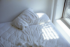 sleeping light (scott w. h. young) Tags: light sun white film window 35mm canon bed fuji room sheets pillows