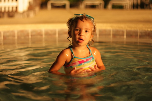 ava in the pool at night