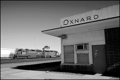 Oxnard Train Station (greenthumb_38) Tags: railroad blackandwhite bw train blackwhite canon300d kitlens amtrak trainstation coastline duotone locomotive digitalrebel southernpacific oxnard cottonbelt jeffreybass