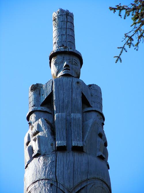 figures atop a totem pole, Kasaan, Alaska
