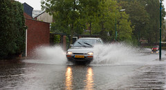 WaterCar (MasterWillems) Tags: road blue red green water rain yellow kids cycling jumping fload splashes carspeople floaded