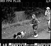 Dog Walker (ryan63rd) Tags: bw film 35mm mono pentax ilford fp4 pentaxmx fd10 worldpentaxday justpentax authenticphotography pentaxart