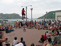 The World Stage (WanderWorks) Tags: canada st festival newfoundland children harbor downtown labrador harbour outdoor hill crowd performance sidewalk unicycle knives busker juggling juggler spectators swords signal johns narrows blindfold img2461fg