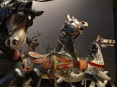 Wild Gallup (Caramel Covered Crack) Tags: carnival red wild horses sculpture museum wooden action circus painted carousel fair amusementpark spotted preserved harness gallup merrygoround chiaroscuro carvings stallion saddle horsey onedeer