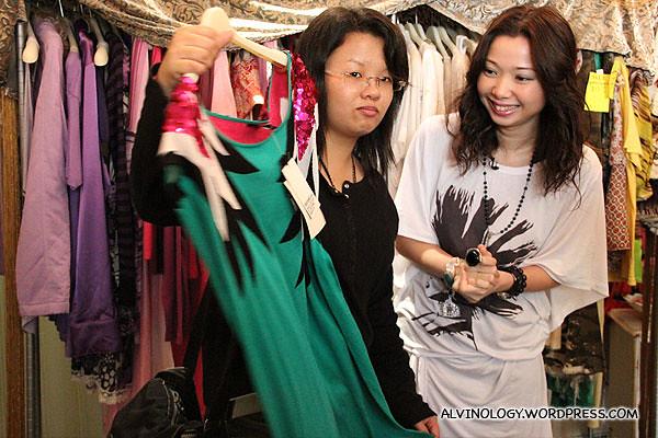 Celia picking out a loud, shiny dress for Tomboy Elaine
