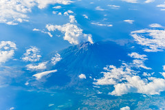 Flying past a volcano (Merrillie) Tags: crater landscape asia nature flying aerial volcano clouds air blue flight plane birdview scenic sky outdoors travel vacations volcanic white mountain