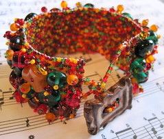 fall embellished peyote cuff (randomcreative) Tags: autumn red orange brown green fall jewelry bracelet etsy embellished glassbeads beadweaving beadwoven offloom randomcreative peyotecuff ceramicbuttonclasp
