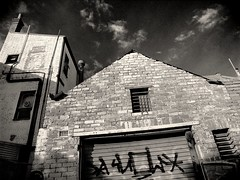 fitzroy gothic #8 (mugley) Tags: old windows chimney sky blackandwhite bw brick 120 film clouds rollei buildings mediumformat prime graffiti alley bars 645 shadows suburban decay pipe fitzroy grain australia melbourne wideangle tags victoria scan negative lane epson suburbs 6x45 r3 mamiya645 urbanlandscape redfilter garagedoor rolladoor polariser 25a id11 v700 mamiya645protl ilfotec m645 rolleir3 35mmf35sekorn forgetexactlywhere offfitzroyst taggershaveittybittycocks