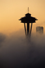 Space Needle in fog (Jim Corwin's PhotoStream) Tags: seattle travel sunset vacation tourism vertical fog skyline architecture sunrise buildings outdoors photography downtown nw cityscape skyscrapers sightseeing foggy silhouettes nobody icon tourists pacificnorthwest spaceneedle iconic silhouetted destinations urbanscene famousplace locallandmark placestosee nationallandmark localattractions famouslocation