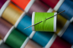 Sewing needle with bright colored spools (Jim Corwin's PhotoStream) Tags: color detail industry thread spools horizontal creativity colorful pattern order needlework embroidery interior sewing patterns crafts craft objects nobody sew row yarn textile fabric needle rows photograph material brightcolors choice variety fiber multicolored sidebyside organization spindle abundance variation crafting apparel fabrics threads conformity reel spool reels manufacture yarns groupofobjects boldcolors largegroupofobjects sewingneedle