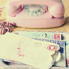reading your letters, wishing you were here (cfisherphotography) Tags: old pink vintage phone stamps letters 1950s squarecrop picnik snailmail comunication rotaryphone