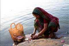 Morning Lightness of Being (Ursula in Aus) Tags: morning woman india water lamp river mud indian mother flame varanasi hindu ganga asi ganges ghat assi kumbh varanasiindia earthasia