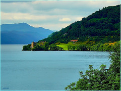 Urquhart castle on Loch Ness, Scottish Highlands (jackfre2 (on a trip-voyage-reis-reise)) Tags: blue trees sky mountains castle water clouds landscape lumix scotland highlands ruins rocky hills romantic greenery loch peninsula urquhartcastle banks lochness ness urquhart drumnadrochit abigfave flickrdiamond lumixaward mygearandmepremium mygearandmebronze mygearandmesilver