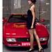 Ferrari and hot asian girl in black dress