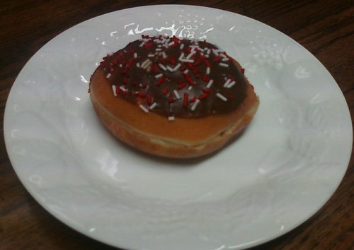 Cheerwine kreme-filled doughnut on a plate