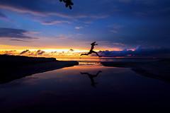 Grenada June 2010 (lauren havenga) Tags: sunset reflection clouds jump moody grenada caribbean grandanse westindies