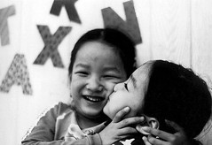 Da In and So Young (Maya Hiort Petersen) Tags: portrait people bw film face smiling kids portraits children happy photo movement eyes kiss funny pretty child minolta photos candid smiles korea korean age expressive feeling emotions ilford aasia mayahiortpetersen hiortpetersen