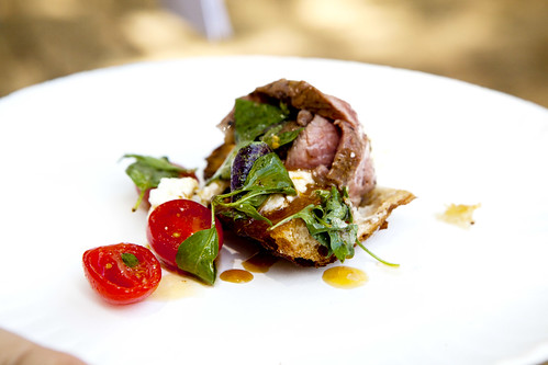 Boqueria's Whole Roasted Lamb with ricotta cheese, basil, cherry tomatoes on a rosemary toast