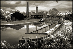 UK - The Midlands - Black Country Museum - Boatyard Infrared (Darrell Godliman) Tags: uk greatbritain travel chimney england urban blackandwhite bw copyright travelling tourism monochrome sepia boats mono boat canal birmingham nikon europe britishisles unitedkingdom britain nb canals industrialrevolution gb infrared dudley toned openairmuseum tinted westmidlands chimneys allrightsreserved brum boatyard canalboat midlands blackcountry travelphotography pseudoinfrared themidlands blackcountrymuseum instantfave blackcountrylivingmuseum omot travelphotographer flickrelite dgphotos darrellgodliman wwwdgphotoscouk bclm d300s nikond300s ukthemidlandsblackcountrymuseumboatyardinfrareddsc1617