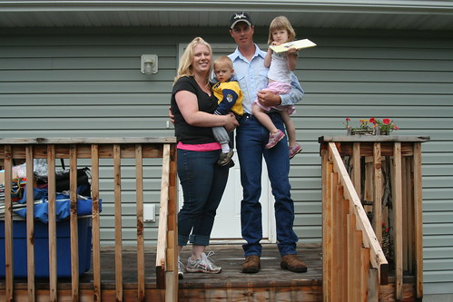 Ted and Kellie baker standing on the deck of their new home.