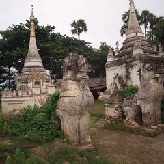 mys000199.jpg (Keith Levit) Tags: sculpture tower animal stone square asian religious temple photography carved ancient shrine asia exterior dragon symbol burma buddhist stonework faith fineart religion towers dragons buddhism carving temples weathered myanmar symbols paya ornate oriental orient figurine burmese religions sculptures carvings decorated likeness buddhistic levit faade keithlevit keithlevitphotography