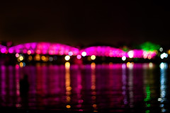 Trang Tien Bridge's bokeh (.kim.e.) Tags: pink light reflection water colors night canon 50mm evening asia southeastasia bokeh vietnam sparkle hue trangtienbridge 450d