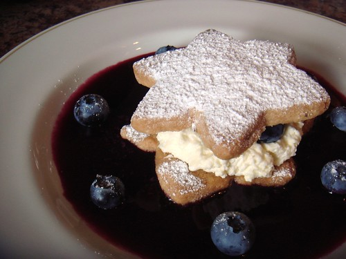 Orange shortcake, whipped cream, blueberry coulis