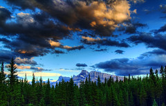 Dusk in the Forest (Jim Boud) Tags: travel blue sunset sky mountain canada mountains green nature pinetree clouds canon lens landscape outdoors eos is nationalpark colorful cloudy hiking rocky wideangle canadian alberta valley northamerica banff layers usm dslr 1785mm digitalrebel photoart digitalslr pinetrees hdr highdynamicrange efs1785mmf456isusm province firtree artisticphotography partlycloudy multipleexposures blendedexposure canadianrockies photomatix imagestabilization imagestabilized 550d jimboud t2i photomatixhdr topazadjust jamesboud eos550d kissx4