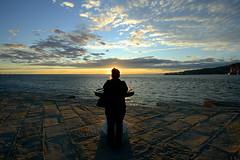enjoying sunset | Trieste (arnabchat) Tags: street blue light sunset sea sky people italy woman reflection water sunshine lady clouds evening europe italia tramonto mare pattern shine wide silhouete acqua fvg trieste adriatic moloaudace 1022canon borgoteresiano