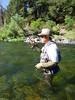 Axel hooks up a strong fish in an emerald glide on the Upper Sacramento River